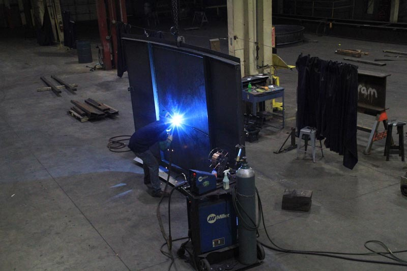 welding large metal fabrication in a shop